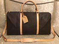 Classic Luxury Designer Women Travel Bag Purse Handväskor Bär OneLauliere Män Klassiker Duffel Väskor Rolling Softsided Väska Bagageuppsättning Gratis Ship 45/50/55 cm