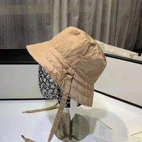 2021 Seyahat Moda Klasik Mektup Cimsi Brim Yaz Toptan Çift Taraflı Güneş Kova Korumalı Balıkçılık Yüksek Kalite Monokrom Bob Kova Şapka Vizör