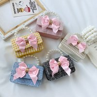 Free DHL INS Pearl Big Bow Bols Bags Baby Girls Princess Mini Bolso One-Shoulder Bolsa Infantil Niño Moda Sweet Crossbody Messenger Bags Niños