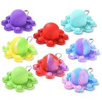 Pop Fidget Toys Wholesale Divertido arco iris volteado Octopus Expresión Flip Doll Silicone descompresión colgante juguete