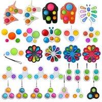 26 estilos de los estilos Fun Fidget Bubble Toys Push Simple Dimple Tecla Key Sensory Squeeze Balls Llavero Unicornio Flor Mariposa