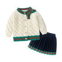Baby Girls Одежда наборы одежды Весна Осень Одежда девушка Хлопок вязаный бежевый полый кардиган с бабочкой + плиссированная юбка 2шт набор детей костюмы детей нарядов