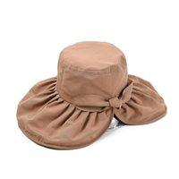 Sombreros de ala ancha China Viaje de verano gorra de sol para las mujeres Anti UV Señoras elegante gorro grande del cubo con el arco Vacaciones Caps Accesorios de playa