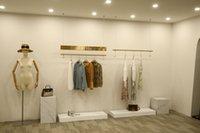 Titulares de armazenamento das mulheres de aço inoxidável Moda de ouro racks penduradas Loja de roupa desenho de fio