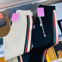 Мужские брюки Joggers повседневные брюки классические эластичные талии хип-хоп мужские спортивные штаны полосы панолируемый карандаш пробег сплошной цвет бег трусцой Rainbow тренд фитнес пот