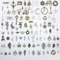 Mixed Multiple Designs Key Clock Flügel Eule Feder Schmetterling Schneeflocke Weihnachtsbaum Charms Für DIY Juwely Make 100pcs / Tasche