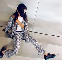 Designer big kids diamond lattice printed clothing sets girls V-neck single breasted long sleeve cardigan+split flare pants 2pcs fall children outfits Q1104