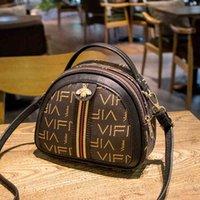 Designer handbags2021 summer net red new Pu women's printing portable single shoulder cross mobile phone small round bagK51O