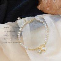 Braccialetto coreano della perla naturale del retro del braccialetto della perla del pendolarismo di modo della marea francese della ribalta