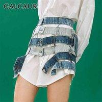 Galcaur Джинсовая голубая юбка для женщин Высокая талия, выдолбленная похудение Хит цвета дизайнер асимметричные мини-юбки женская летняя одежда 210629