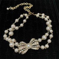 Xiangjia 2021 new necklace women's clavicle pearl sweater chain autumn and high grade small fragrant bow