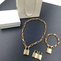 ファッションブレスレットネックレスイヤリングスーツマン女性ユニセックスチェーンブレスレットネックレス真鍮ジュエリースーツ高品質ボックスなし