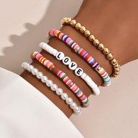 Joyería hecha a mano al por mayor 2021 pulsera colorido suave cerámica personalidad perla pulsera amor 5 pieza conjunto joyería