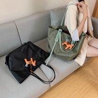 2021 summer new pure color canvas women's bag dog pendant water repellent nylon simple one shoulder handle mother