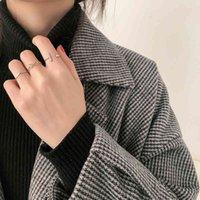 Simple personalidad coreana de cuatro piezas conjunto de combinación de mujer triángulo apertura moda moderna articulación pequeño anillo