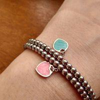 Logo Luxus Herz Perlen Armband Frauen Edelstahl Stränge Kette Auf Hand Geschenke Für Freundin Zubehör Rosa Rot Grün Blau Großhandel