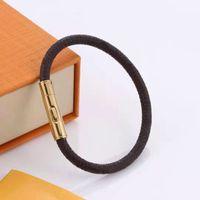 Kobieta Bransoletka Moda Bransoletki Dla Mężczyzna Kobiet Skórzany Łańcuch Biżuteria Unisex Wristband 2 Style Dobra jakość z pudełkiem