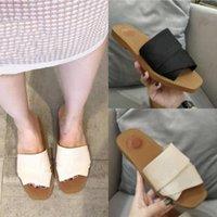 Ursprünglicher Stil Hohe Qualität Woody Mules Flache Slipper 2021 Frauen Mode Deisgner Buchstaben Kreuz Weave Canvas Strap 9 Farben Strand Flip Flop Schuhe Sandalen