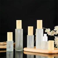 Замороженный стеклянный бутылка для крем для бутылки с имитированными древесными крышками лосьон спрей для насоса бутылки насоса.