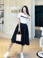 2021 ABD En Moda Etekler Kadın Marka Alışveriş Elbise İthal Naylon Rahat Ve Hacimli Tarzı Klasik Siyah Beyaz Sıralama Zamansız Yaz Etek