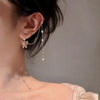 Goujon tendance boucles d'oreilles femmes coréenne tempérament tempérament papillon pompon bijoux haut de gamme pour femme fille