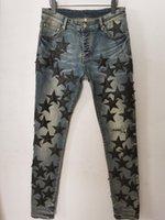 Pantaloni da uomo Pantaloni lunghi Pelle Skinny Star Star a cinque punte Distruggi la trapunta Strappata Hole Fashion Designer Jean Designer Designer