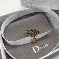 Boutique Anillos D familia 21 Diamante completo Lucky Grass CD letra letra red rojo simple anillo de estrella