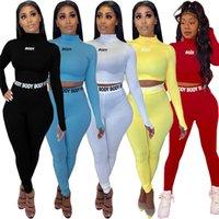 Mujeres Yoga Sportswear de manga larga Trajes de manga larga Dos piezas Moto Moto Conjuntos Slim Jogging Stics Tops de cultivos Leggings Tripsuits de moda Trajes Casuales S-2XL 5627