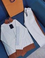 21fw mode tricoté costumes pour hommes Femmes Tracksuits avec lettres Stylistes Cardigan Cardigan Cardigan Pantalons 2 couleurs Casual Womens Sportswear
