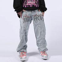 Pantalones de jeans de cadena de bordados con letras Pantalones de jeans para hombres y mujeres estilo lavado de gran tamaño casual pantalones de mezclilla
