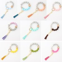 US-Bestreitungs-Party-Favor Keychain-Hölzerne Quaste-String-Kette Lebensmittelgrade Silikon-Perle Frauen Mädchen Schlüsselanhänger Handgelenkband Armband