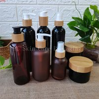 Wholesale Amber black frosted  white clear plastic bottles and cream jars bamboo cap bottle cosmetic containers jar bulkgoods