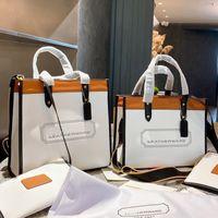 Designer Mulheres Campo Casual Tote Luxurys Designers Sacos 2021s New-York emblema Retalhamento Saco De Ombro Shopping Bolsas Couro Cruzbody Bolsa de Alta Qualidade