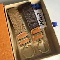 Top Luxury Designer Keychain Dauphine Dragonne Bag Pingente Charme 2021 Homens Mulheres Carrinho Chaveiro Chaveiro Chaveiro De Couro Chaveiros M69313 M69000 com caixa