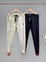 Pantalones de pistas para hombre Trozo de playa de verano para hombres Mujeres Unisex con letra impresa Outwear Outwears Street Pantalones Suéter Pantalón Drawstring Ajustar M-2XL