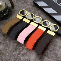 Fashion High Quality Cell Phone Cinturini portachiavi portachiavi di lusso vecchio fiore lettera portachiavi in pelle per chiavi auto anello decorazione accessori