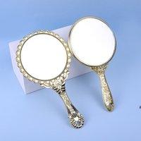 Mano de maquillaje de mano Hold Romántico Vintage Hold Sujetador Zerkalo Gilded Manija Oval Round Cosmetic Mirror Make Up Tool Cómoda Regalo HWB7183