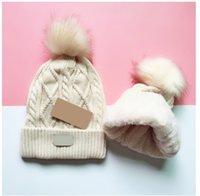 5 Цвета Высококачественные Зимние Шапки Шляпы Женщины и Мужские шапочки с реальными помпами енотных помпонов теплые оптом