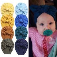 Chapéu recém-nascido chapéus Índia Chapéus de coelho orelhas nó boné Bowknot multi - cor pulôver bonés Bebê headband primavera e verão wmq889