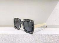Lunettes de soleil design de mode 0780S Cadre carré Pochette avec diamants Style Trendy Summer Outdoor Lunettes de protection UV400 Top Qualité