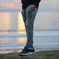 Pantalon Pantalon de survêtement gris Jogger Great Hommes Gym Fitness Pantalon Crayon Mode Print Ciseaux Sportswear