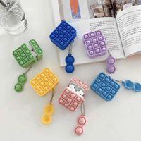 赤とピンクのイヤホンスリーブ指の減圧玩具プレスバブルゲームおもちゃ不安ストレスリリーフ実用的かつ運ぶのが便利