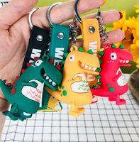 장난감 창조적 인 만화 공룡 인형 열쇠 고리 남자와 여자의 자동차 체인 스테레오 연도 펜던트 작은 선물
