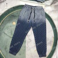 21SS FRANCIA Hombre Para mujer Pantalones de diseño Moda Italia Pantía gradiente Jacquard letra Metal Botón Hombres Mujeres Casual Algodón Negro Negro Azul Xinxin