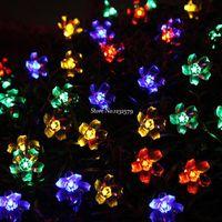 弦100m 600 LED妖精のひもライト桜の花の花のクリスマスの結婚式の装飾ルミナリスランプのランプの花輪