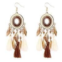 Европейская и американская мода богемный диск листьев шерсти кисточки серьги с жаркой ухо ювелирные изделия оптом 965 Q2