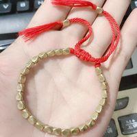 Hecho a mano trenzado Lucky Rojo Hilo Tibetano Buddhist Cobre Beads Brazaletes Brazaletes para mujeres Hombres Charm Pulseras de joyería