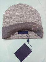 الجملة قبعة الشتاء قبعات القبعات النساء والرجال بيني مع ريال الراكون الفراء pompoms الدافئة فتاة قبعة snapback pompon