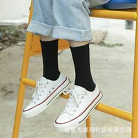 Black stockings children's middle tube trend Korean autumn and winter pure white long thickened cotton lovers all