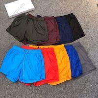 مصممون رجالي s shorts 9 ألوان قصيرة الرجال والنساء الصيف التجفيف السريع للماء عارضة خمس نقاط السراويل حجم S - 3XL